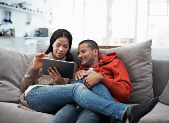 Couple reviewing investment options on their tablet