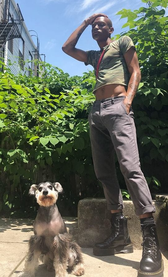 Jalen Dominique with his dog Gio. (How much do pets cost?)