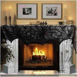 27 Cheap Halloween Party Ideas for Under $27: Fireplace with spiderweb mesh