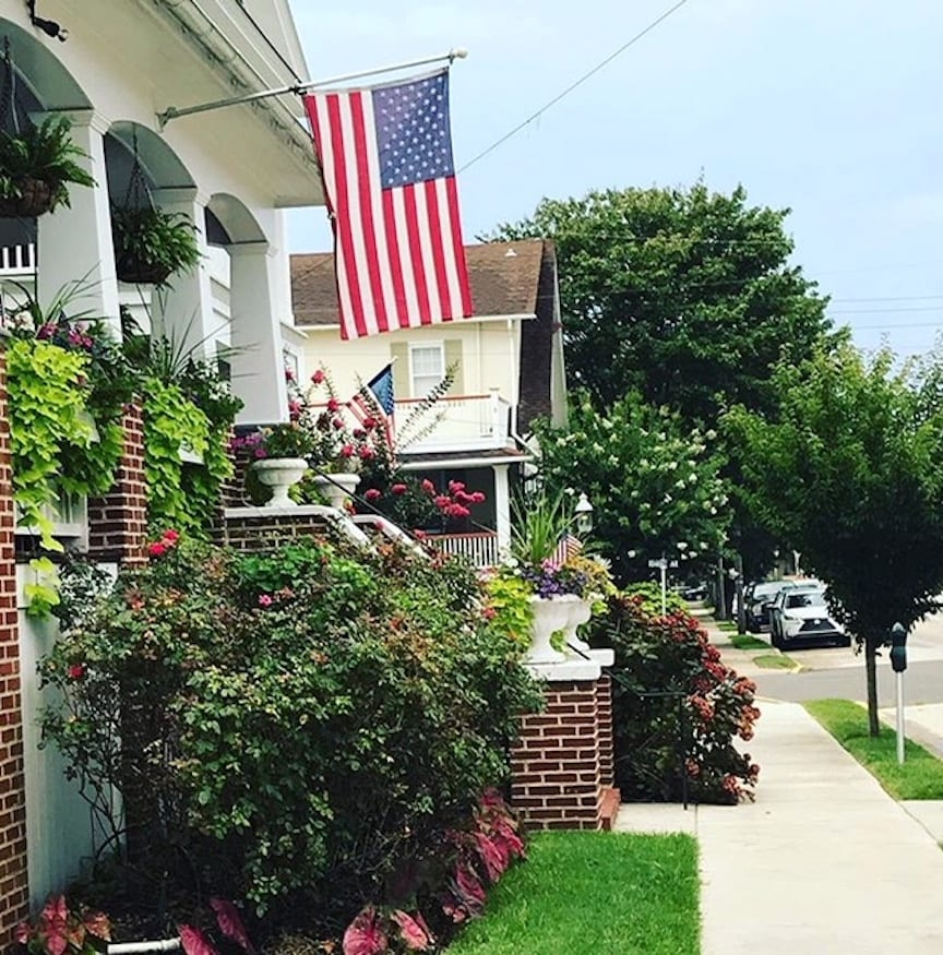 When and How to Work From Home: Amazon work-from-home jobs   Photo of a suburban house with an American flag   Photo by Rita Pouppirt