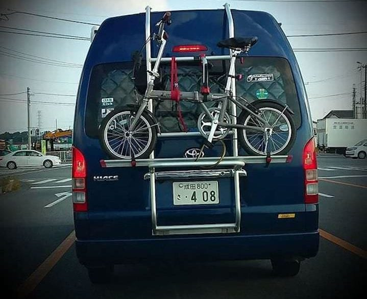 Leasing vs. Buying a Car: What's the Best Choice for You? | Photo of a car with a bike strapped to the back | Photo by Daye Deura