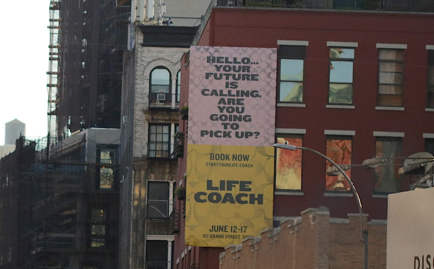 """Forget Making New Year's Resolutions — Take Action Instead   Photo of a large ad painted on the side of a brick building. It reads, """"Hello... Your future is calling. Are you going to pick up?""""   Photo by Liem Ericson"""