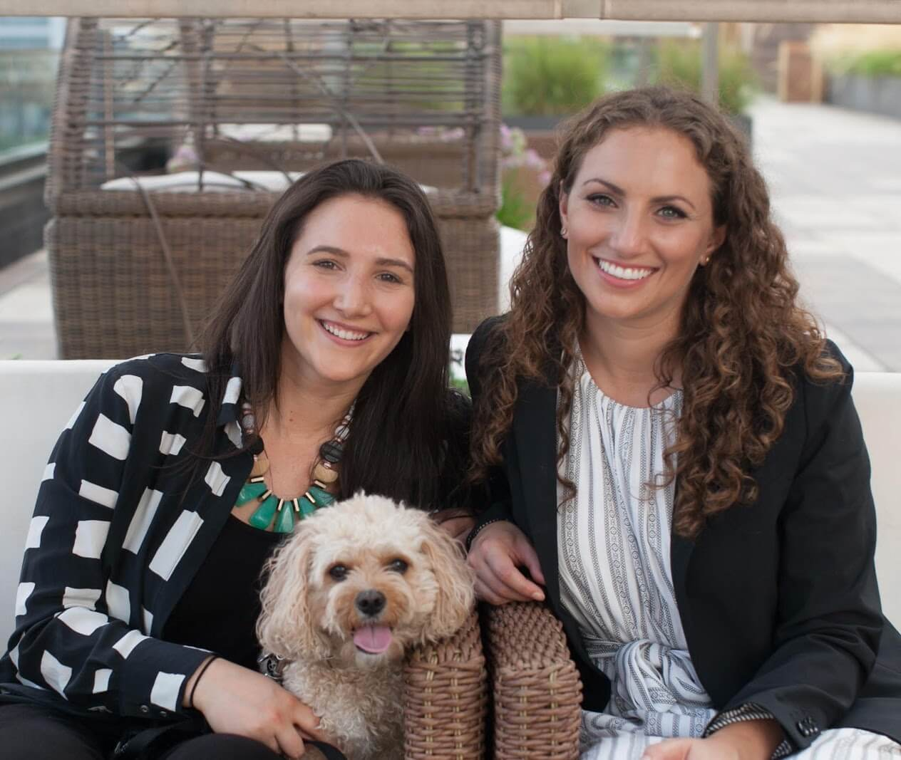 Casey (left) and Leigh Isaacson with dog Layla (center) | National Siblings Day | Working with siblings